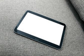 Blank digital tablet on the couch — Stock Photo