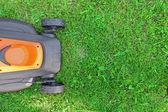 Lawnmower on green grass — Stock Photo