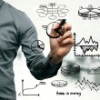 Businessman drawing different graphs, charts and business elements — Stockfoto