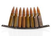 Gun bullets isolated on white background — Stock Photo