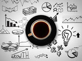 Cup of coffee on background of business strategy — 图库照片