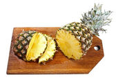 Sliced pineapple on wooden board isolated on white — Stock Photo