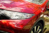 Closeup of modern red sport car headlight — 图库照片