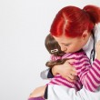 The pediatrician comforted a little girl — Stock Photo #20047443