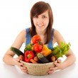 A young woman with a basket full of vegetables — Stock Photo #25111265