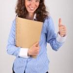 mladý obchodní žena drží souboru ve svých rukou — Stock fotografie #28955527