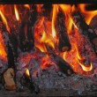 Stock Photo: Firewood burns in furnace