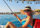 Girl in hat on catamaran at sea — Stock Photo
