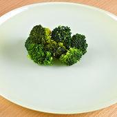 Green broccoli on green dish. — Stock Photo