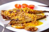 Spanish dish mackarel with orange-lemon sauce — Stock Photo