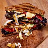 Chicken club sandwich on wooden board — Stock Photo