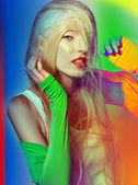 Fashion blond girl in color effect whith stylish hairdress — Stock Photo