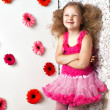 Stock Photo: Portrait little lovely girl in a pink dress