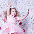 Stock Photo: Little baby in pink dress jumping and smile