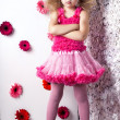 Portrait little lovely girl in a pink dress — Stock Photo #13217000