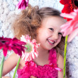 Portrait happy little lovely girl in a pink dress — Stock Photo
