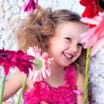 Portrait happy little lovely girl in a pink dress — Stock Photo