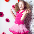 Portrait little lovely girl in a pink dress — Stock Photo #13217118