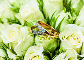 Beautiful background with wedding rings — Stock Photo