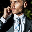 Men in  suit speaks by phone babbling down — Stock Photo