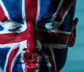 Stylish young man with emblem of Great Britain. — Stock Photo