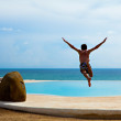 Guy jumping to  pool in — Stock Photo