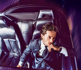 Beauty stylish guy in car . — Foto de Stock