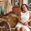 Portrait of a beauty woman in stylish room — Stock Photo