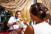 Happy couple with wine glass — Stock Photo