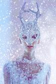 Beautiful woman face in mask — Stock Photo