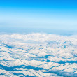 Mountains and sky, view from airplane - Stock Photo