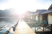 Sunrise in mountains at beautiful lake in reserve , sun beams in shot . Thailand — Stock Photo