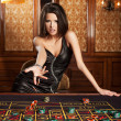 Young sexy girl in casino — Stock Photo #30803305