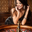 Young sexy girl in casino — Stock Photo #30804641