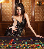 Young sexy girl in casino — Photo
