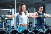 Young beautiful girl exercise with personal trainer — Stock Photo