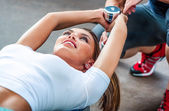 Young beautiful girl exercise with personal trainer — Stockfoto