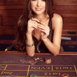 Stock Photo: Young sexy girl in casino