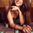 Young sexy girl in casino — Stock Photo
