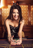Young sexy girl in casino — Stockfoto