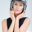 Beautiful girl in helmet from scooter poses front chamber — Lizenzfreies Foto