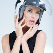 Beautiful girl in helmet from scooter poses front chamber — Stock Photo