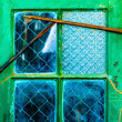 Isolated old neglected green window — Stock Photo
