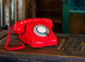 Vintage rotary red telephone — Stock Photo