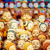 Mob of doll faces — Stock Photo