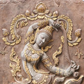 Bas-relief decorated on temple's wall — Stock Photo