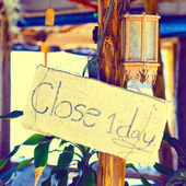 "Yellow sign ""close one day"" in Thailand public establishment — Stock Photo"