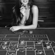 Young sexy girl in casino — Stock Photo #34267569