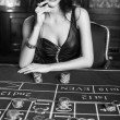 Young sexy girl in casino — Stock Photo #34267605