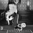 Young sexy girl in casino — Stock Photo #34267693